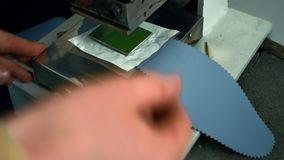 Hand pound stamp press in work. Leather manufacturer stamping shoe insole
