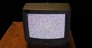 Hand pounding retro TV with snow noise and sound stock video footage