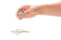 Hand pouring a bucket of coins Royalty Free Stock Image
