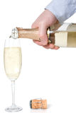 Hand pouring champagne in a glass Royalty Free Stock Photography