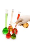 Hand pouring chemicals. Isolated on the white Stock Image