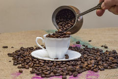 Hand pouring coffee beans Royalty Free Stock Photo