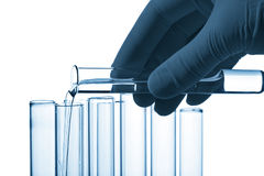 Hand pouring liquid into test tube isolated Royalty Free Stock Image