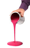Hand pouring paint from tin can Royalty Free Stock Images