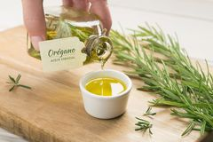 Rosemary essential oil with spanish tag. royalty free stock photography
