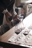 Hand pouring wine Stock Images