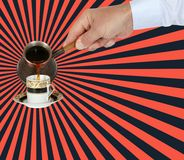 Hand pours arabic coffee into a cup from turkish pot, cezve or ibrik. Dynamic illustration. Hand pours arabic coffee into a cup from turkish pot, cezve or ibrik stock photography