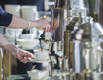 Hand pours coffee Royalty Free Stock Photography