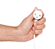 Hand with  power plug Royalty Free Stock Photos