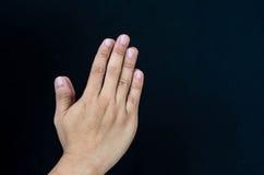 Hand pray. On the black  background Stock Photo
