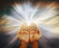Hand prayer. Prayer raised hands on cloudy background Royalty Free Stock Photography
