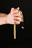 Hand praying with chain Stock Photography