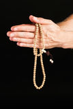 Hand praying with chain Stock Images