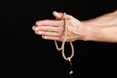 Hand praying with chain Stock Photo