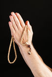 Hand praying with chain Royalty Free Stock Image