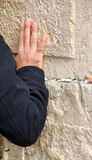 Hand of praying man on the Western Wall Royalty Free Stock Photography