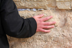 Hand of praying man on the Western Wall Royalty Free Stock Photos