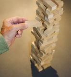 Hand with precarious building blocks Stock Photos