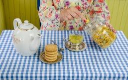 Hand prepare marigold herb tea Stock Photo