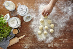 Hand preparing dough for homemade pasta atmospheric kitchen Royalty Free Stock Images