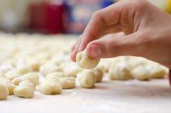 Hand preparing homemade italian gnocchi Royalty Free Stock Images
