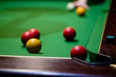 A hand preparing to play a pool shot. Into the corner Stock Image