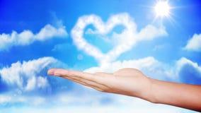 Hand presenting heart cloud design. Digital animation of Hand presenting heart cloud design stock video