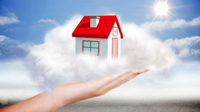 Hand presenting house graphic in cloud stock video footage