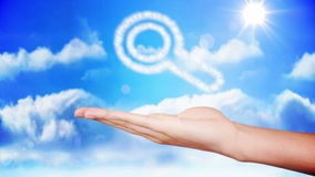 Hand presenting magnifying glass cloud design stock footage