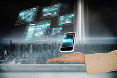 Hand presenting smartphone and interfaces Stock Images