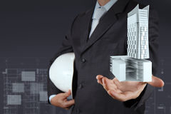 Hand presents building development as concept Stock Photo
