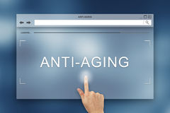 Hand press on anti aging button on website Stock Photo