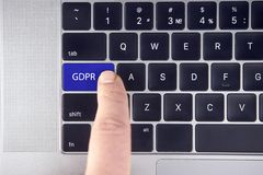 Hand press the button GDPR on keyboard laptop