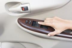 Hand press button inside door car Stock Images