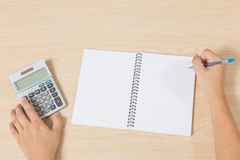 Hand press calculator and writting on notebook Royalty Free Stock Photos