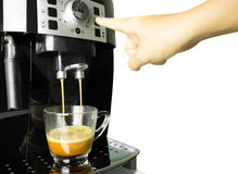 Hand press coffee machine making cup of coffee isolated. In white background Royalty Free Stock Image