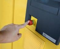 Hand press emergency botton. Hand pressed emergency button of machine Stock Photo