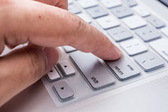 Hand press enter button. On computer Royalty Free Stock Images
