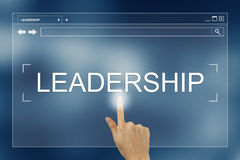 Hand press on leadership button on website Stock Images