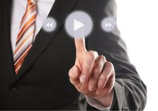 Hand press play button. A business hand press play button on touch screen stock photo