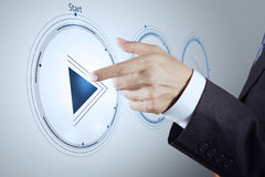 Hand press play button sign to start or initiate. Projects as concept Royalty Free Stock Image