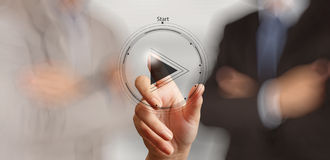 Hand press play button sign to start. Or initiate projects as concept Royalty Free Stock Photos