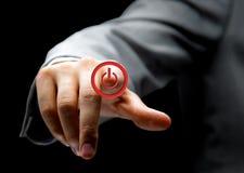 Hand press power button Stock Photos