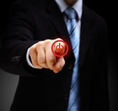 Hand press power button Stock Photography