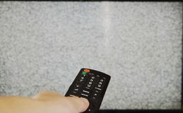 Hand press television remote control for searching signal Royalty Free Stock Images