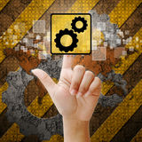 Hand press touch gear symbol Stock Photos