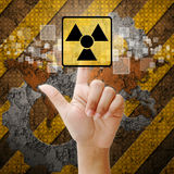 Hand press touch Nuclear symbol Royalty Free Stock Photos