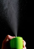 Hand presses the air freshener on black background Royalty Free Stock Image