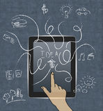 The hand presses arrow on tablet with icons Royalty Free Stock Images