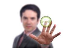 Hand presses the button Stock Photo